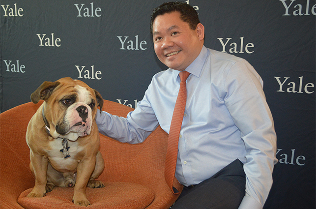 Handsome Dan, Yale's mascott with DNP'18 graduate, Dr. Aries Limbaga