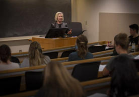 Mary C. Geary '74 MSN, RN teaching a class on Negotiation